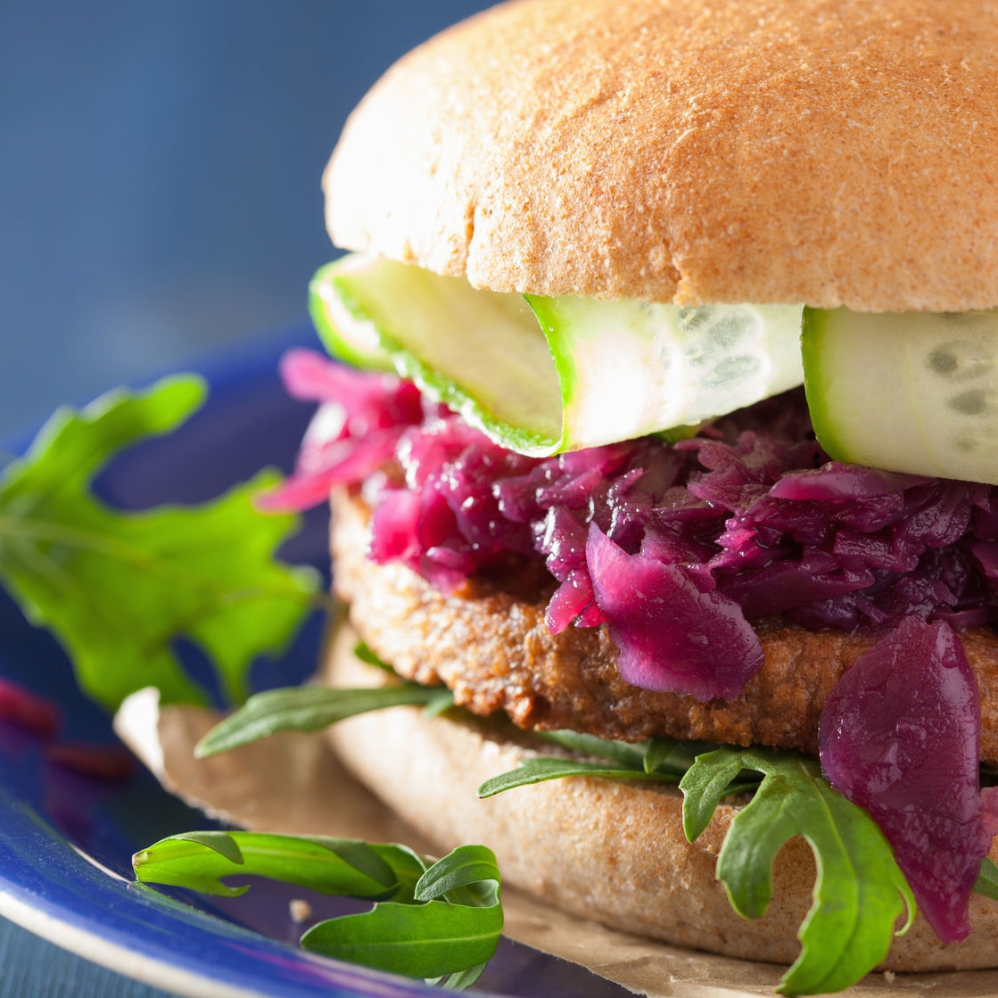 vegan soy burger with pickled, red cabbage, cucumber, arugula