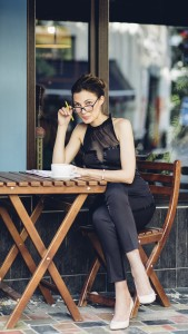 attractive girl with a notepad in the cafe